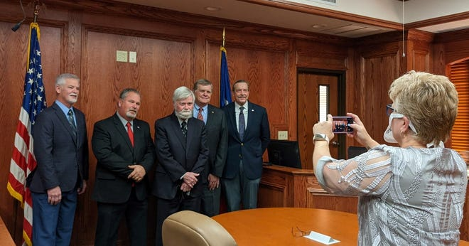 Wichita County Commissioners Court Administrator Nancy Gregory takes a photo of the members of the CC, from left to right, Precinct 1 Commissioner Mark Beauchamp, Precinct 2 Commissioner Mickey Fincannon, county Judge Woody Gossom, Precinct 3 Commissioner Barry Mahler and Precinct 4 Commissioner Jeff Watts on Dec. 14, 2020. The photo is destined for wichitacountytx.com.
