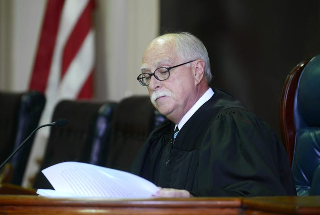 Muskingum County Common Pleas Judge Mark C. Fleegle is disqualified from two cases proceeding in his courtroom after Supreme Court Justice Maureen O'Connor ruled his COVID-19 protocols put the public at risk.