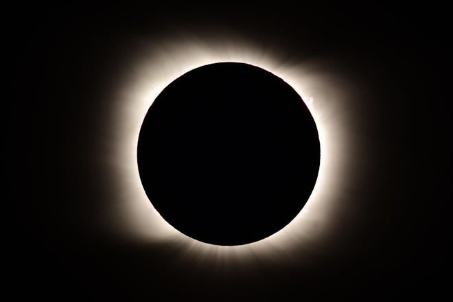 TOPSHOT - The total solar eclipse as seen from Piedra del Aquila, Neuquen province, Argentina on December 14, 2020.