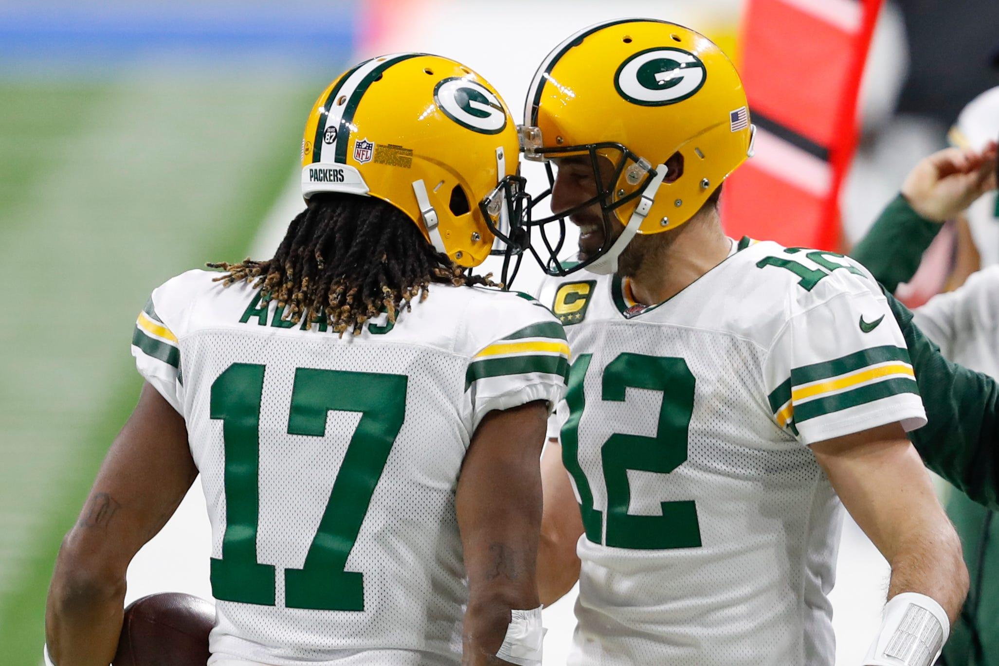 Green Bay Packers clinch NFC North, take lead in race for NFC's top seed by outlasting Detroit Lions