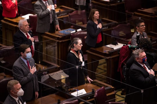 Electors recite the Pledge of Allegiance during Tennessee's 2020 Electoral College at the State Capitol in Nashville, Tenn., Monday, Dec. 14, 2020.