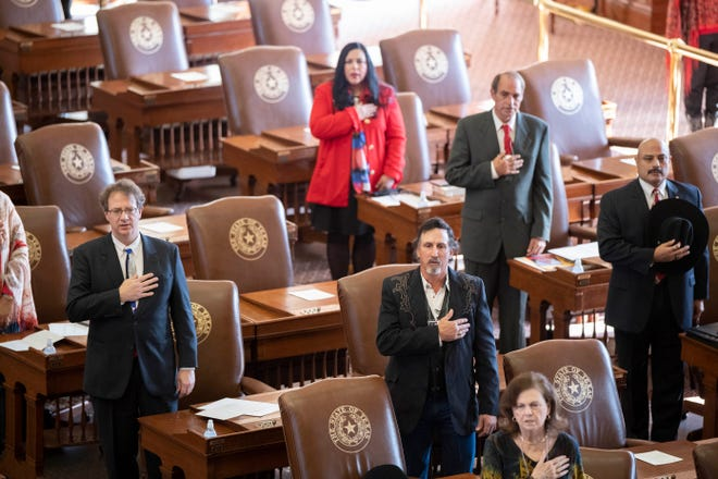 Texas presidential electors recite the Pledge of Allegiance to cast ballots for President Donald Trump at the Electoral College vote Monday afternoon in the House Chamber. As expected, all 38 Texas votes went to the president and vice president.