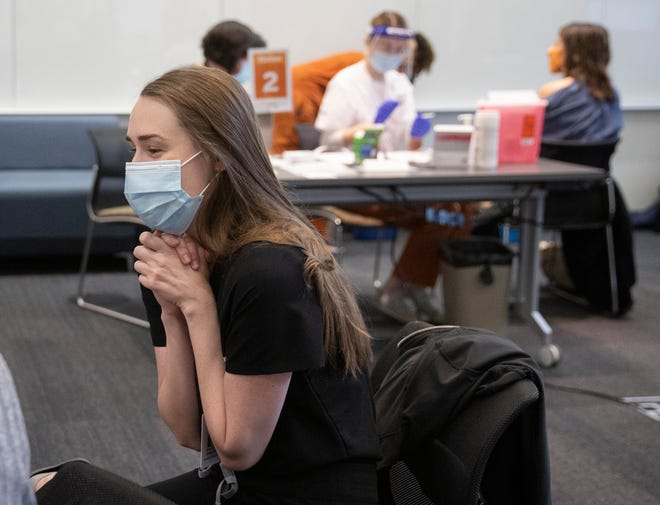"Dr. Margaret Coates said getting the coronavirus vaccine was ""really a moment of catharsis."" The University of Texas Dell Medical School resident was among the first in Austin to get the vaccine Tuesday."