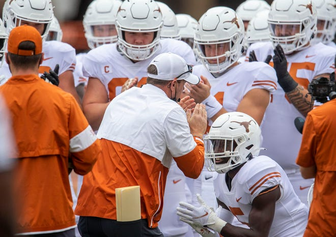 Texas head coach Tom Herman warms up his team before the Longhorns' win over Baylor in October.