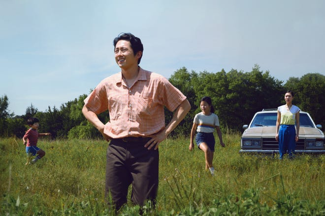 """Steven Yeun (center) stars as Jacob in writer-director Lee Isaac Chung's """"Minari."""""""