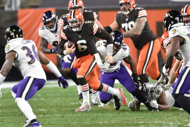 Cleveland Browns quarterback Baker Mayfield (6) rushes during the second half of an NFL football game against the Baltimore Ravens, Monday, Dec. 14, 2020, in Cleveland. (AP Photo/David Richard)