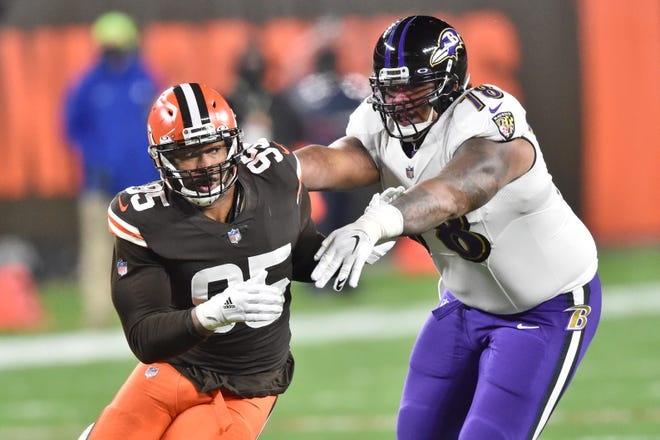 Browns defensive end Myles Garrett (95) runs around Baltimore Ravens offensive tackle Orlando Brown (78) during the first half of the Browns' 47-42 loss to the Ravens on Monday night. [David Richard/Associated Press]