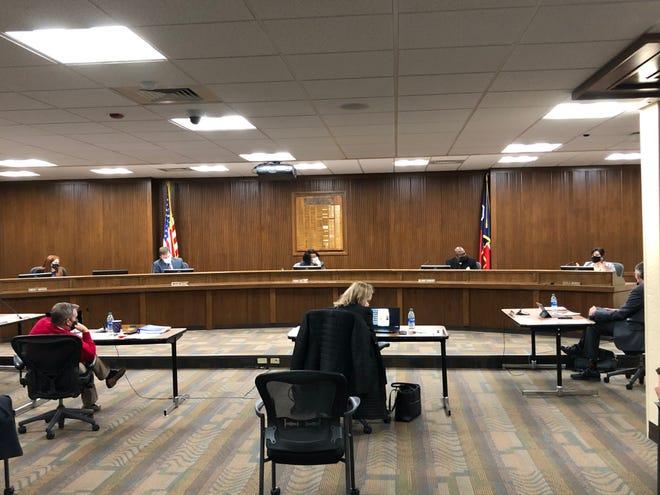Members of the Amarillo ISD Board of Trustees participate in December's regular meeting. [David Gay/Amarillo Globe-News]