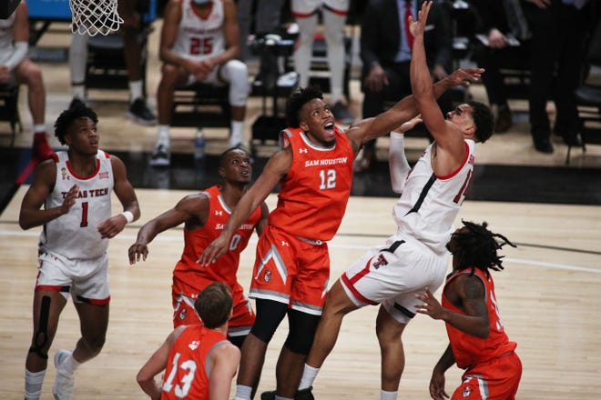 Sam Houston State forward Tristen Ikpe, center, was a standout at Blinn College before he transferred to the Bearkats. At Blinn, he averaged 17.3 points and 10.4 rebounds a game.
