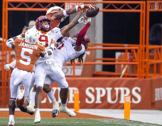 Texas cornerback Josh Thompson (top) swats the football out of the hands of Iowa State receiver Tarique Milton (1) on Nov. 27, 2020 in Austin.