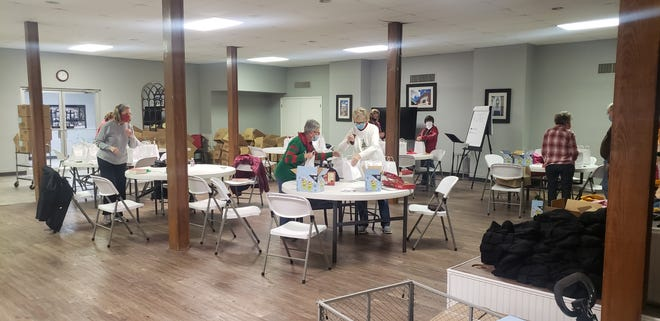 Members of the First Presbyterian Church Mission and Outreach team put together goody bags for every student at Charles Evans, Lincoln and Jefferson Elementary Schools. Each bag contains a hat, gloves, a candy cane and fruit gummies.