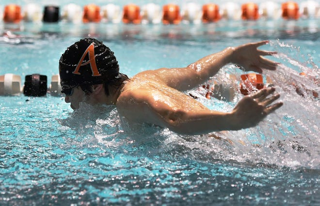 Ames' Hanyu Ning, seen here swimming the 100-yard butterfly in a dual meet against Ankeny at Ames Dec. 14, 2020, was part of three victorious events for the Little Cyclone boys' swimming team in a 117-53 dual meet win over Dowling Catholic Monday at West Des Moines.