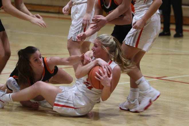 Ames's Elaina Deardorff goes down to battle an Ottumwa player for a loose ball during the No. 11 Little Cyclones' 64-47 victory over the Bulldogs to open the season Monday at Ottumwa.