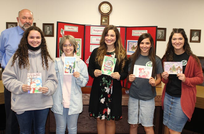 Holiday card winners pictured with Superintendent Cooley.