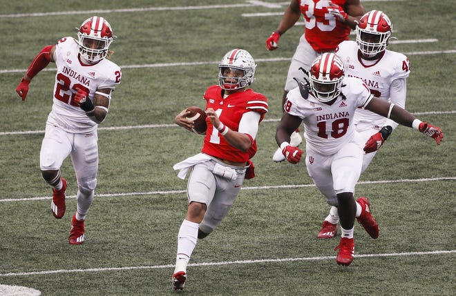 Ohio State quarterback Justin Fields finds running room against Indiana on Nov. 21 in Ohio Stadium.