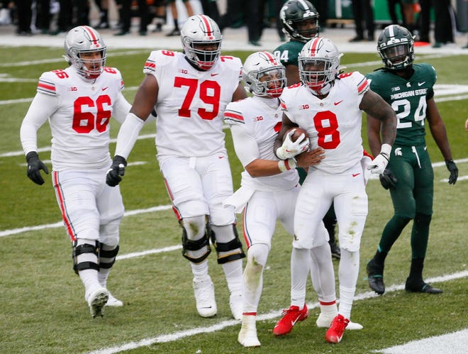 Ohio State running back Trey Sermon (8) celebrates after running the ball to the 1-yard line during the second quarter.