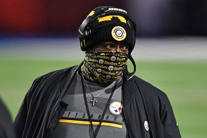 Pittsburgh Steelers head coach Mike Tomlin walks on the sideline during the first half against the Buffalo Bills on Sunday.