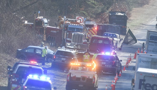 Rescue personnel work at the scene of a three-vehicle crash Tuesday morning on Route 6 in West Barnstable.