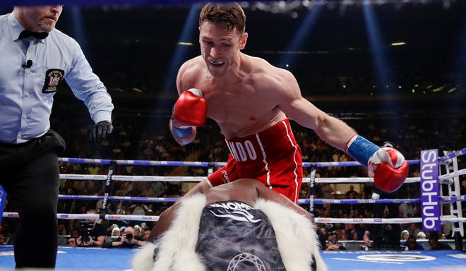 Callum Smith knocks down Hassan N'Dam in the first round of a super middleweight championship match in New York in 2019.