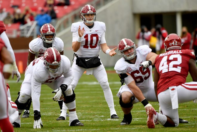Alabama quarterback Mac Jones (10) gets ready to run a play against Arkansas during a game Saturday in Fayetteville, Ark.