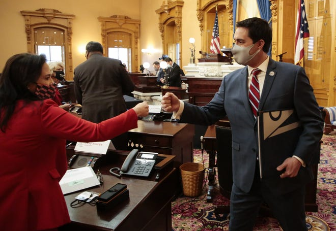 Ohio Elector and Republican Party Chairwoman Jane Timkin, left, greets Secretary of State Frank LaRose after electors cast their votes during the 55th Electoral College on Monday, Dec. 14, 2020, at the Ohio Statehouse in Columbus. Ohio's 18 electors cast their votes for President Donald J. Trump, who won the state's popular vote.