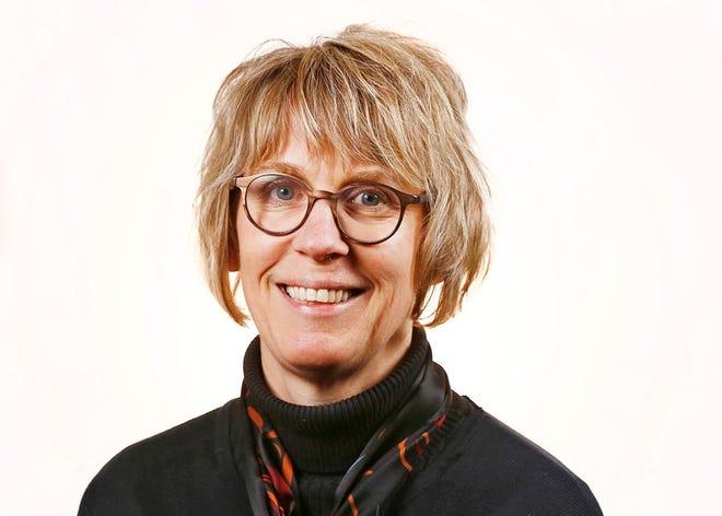 Mary Mogan Edwards,  Editorial Page Editor