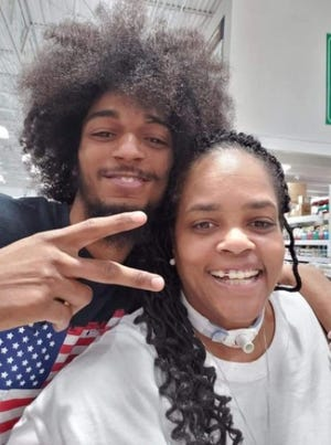 This photo of Casey Goodson Jr. and his former sixth-grade math teacher at Columbus City Schools, Malissa Thomas-St. Clair, was taken when the two of them ran into each other at a Menards store last year.
