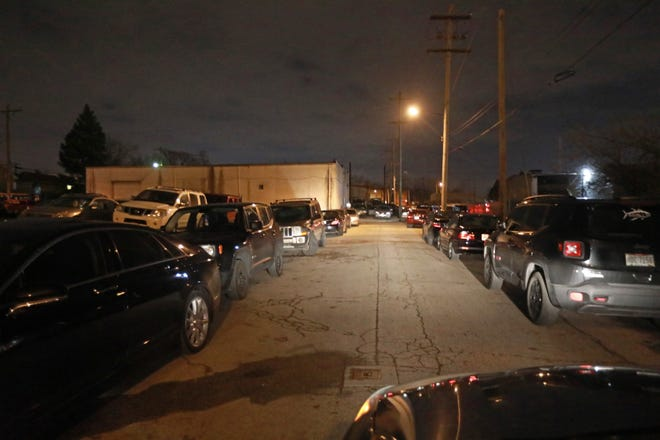Vehicles line Reynolds Avenue in Columbus in this file photo.