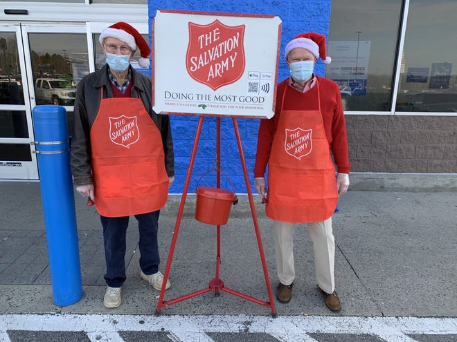 Randolph Rotarians Stuart Fountain and Derrick Grantham served as two of the 24 Salvation Army bell ringers collecting donations outside of the Asheboro Walmart on Dec. 12. Also part of the 24 bell ringers who served this day were Kristen Phillips and Alex Scruggs, Southwestern Randolph High School Rotary Interact Club members.