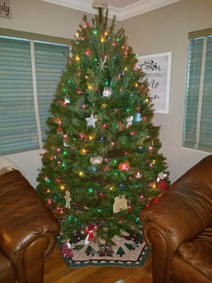 A decorated Christmas tree, ready for the holidays.