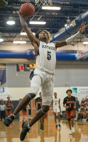 Eustis' Karlton Walton (5) puts up a shot at a game against Umatilla earlier this season. Eustis is one of eight teams from Lake and Sumter counties competing in the first Lake-Sumter boys basketball tournament, which begins Wednesday at Leesburg. [PAUL RYAN / CORRESPONDENT]