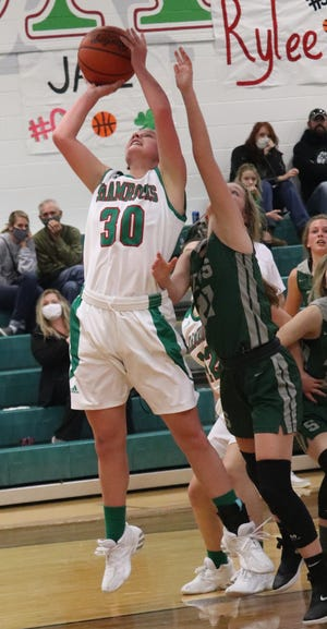 Barnesville senior Rylee Stephens (30) pulls down a rebound during Monday's match-up with visiting Shenandoan High.