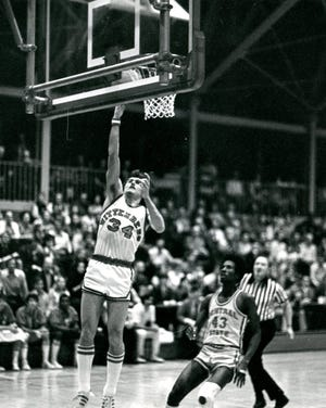Steve Moore goes up for a layup during his playing days at Wittenberg. His alma mater, which eventually became his rival as College of Wooster's head coach, voted Moore into its Athletics Hall of Honor.