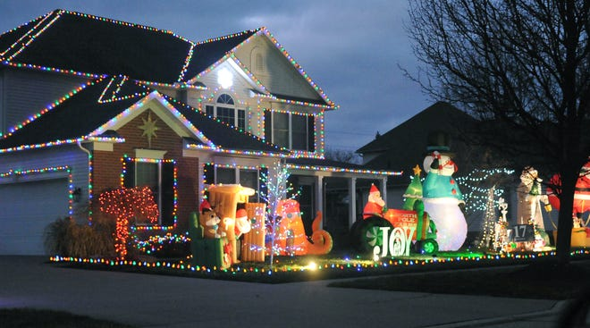 """This home at 810 Meadow Lane in Wooster is one of 40 homes registered in the Wooster Area Chamber of Commerce's """"Let it Glow."""" The residential holiday lights contest runs through Dec. 29."""