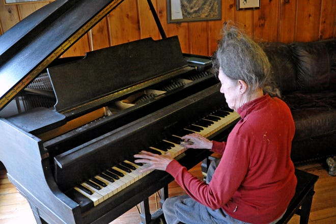 Marjorie Gallagher enjoys playing the long-lost family piano, which she played as a young girl.