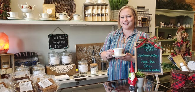Jessica Nance, owner of Nature's Cottage in Lexington, stands behind the store's newest addition -- a hot tea bar. Nance purchased the store in November 2019 and has worked to add services and products to the retail shop on Main Street that specializes in all-natural, organic spa services and products.