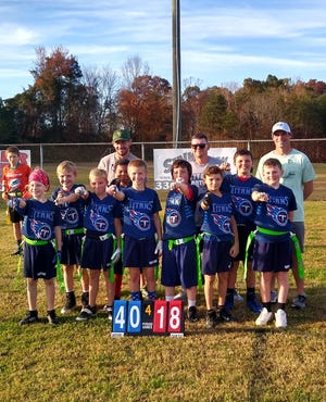 The Reeds Titans won the Davidson County U10 flag football Super Bowl. Team members are (front row, from left) Ezra Thompson, Brayden Cline, Sam Deremer, Kenneth Mott, Zack Ross, William Jordan, Ean Short, Jake Edwards, Jaxson Hartley (Not pictured: Hudson Shoaf); (back row) coaches Kevin Potts, Chris Edwards and Chris Deremer.