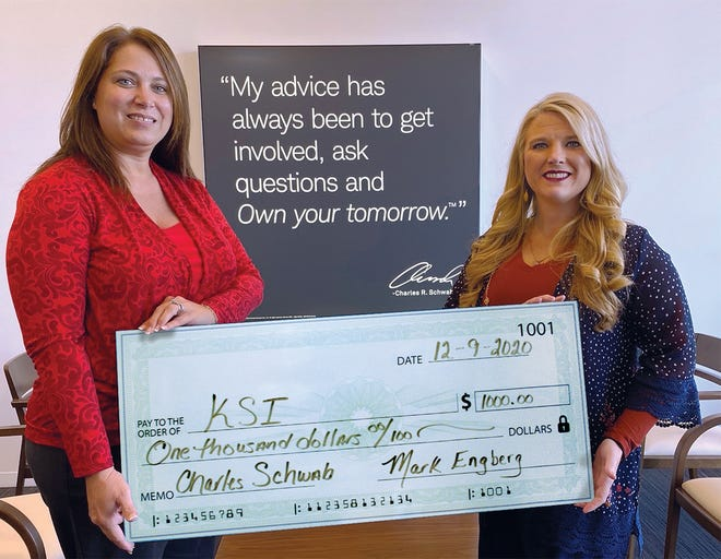 Kent-Sussex Industries Inc. Vice President of Mission Advancement Ann Haggerty accepts a donation from Stephanie P. Brown, independent financial consultant with the Charles Schwab & Co. office in Rehoboth Beach. Mark E. Engberg, independent branch leader, was unable to be in the photograph but encouraged the community to support KSI.