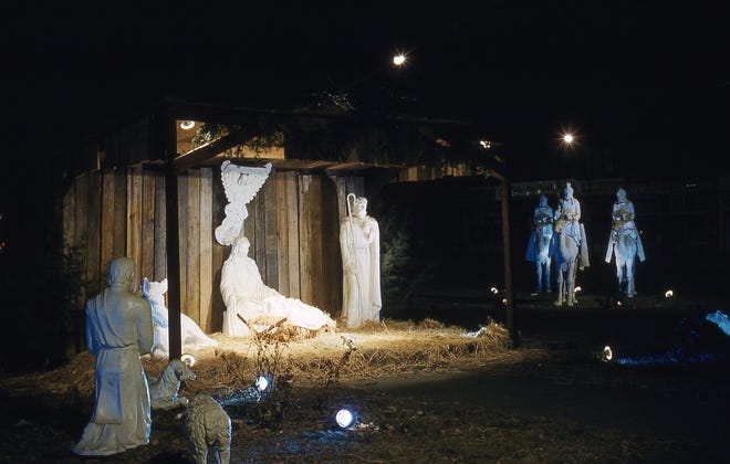 Mounted on camels, three wise men approach the illuminated stable on the Monmouth Public Square. Photo by Paul Kobler.