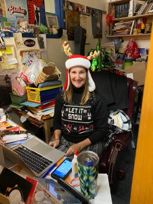 Roz Bingaman, choir director, looked very festive teaching a virtual class Monday, when she also was helping with the winter concert recording.