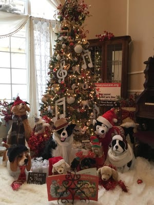 """""""Bark! The Hairy Angels Sing,"""" decorated by Elizabeth """"Liz"""" Gutting and sponsored by Because You Care Inc., was the first-place winner in Saint Vincent Hospital's 2020 Festival of Trees. This year's event featured a drive-through display and a virtual gallery due to the coronavirus pandemic."""