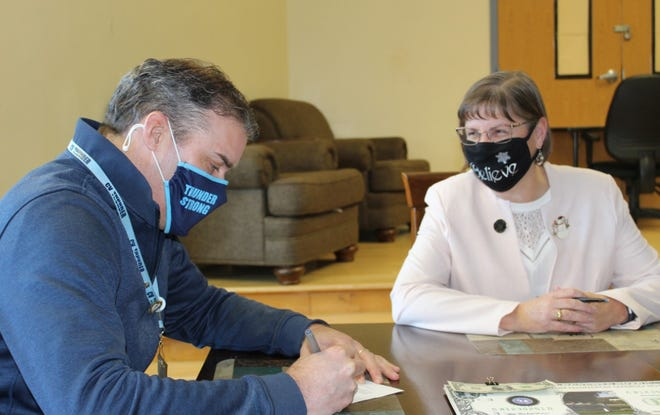 Central Valley Superintendent Jeremy Rich and Herkimer BOCES District Superintendent Sandy Sherwood sign the closing documents, finalizing BOCES' purchase of the former Remington Elementary School from Central Valley.