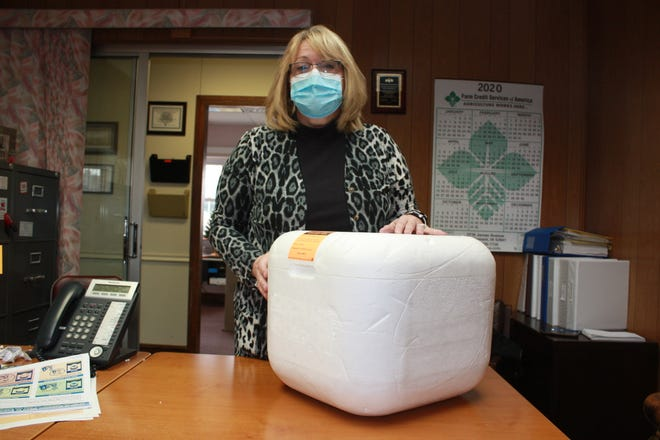 Des Moines County Public Health Administrator Christa Poggemiller is shown with a container used for cold vaccine shipping Tuesday in her office at Des Moines County Public Health. The container held vaccines that had to be stored in temperatures of between 2 and 8 degrees Celsius. The Pfizer vaccine must be stored at temperatures of between negative 60 and 80 degrees Celsius, though it can remain outside of cold storage for up to five days if it is in a non-diluted form. When diluted, it is only good for up to six hours.