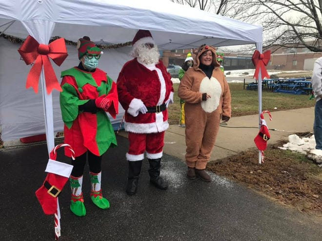 Santa was joined by members of the Christmas Parade Committee when he visited Somersworth on Sunday, Dec. 13.