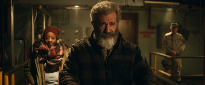 """To help finance their gift-giving gig, Chris Cringle (Mel Gibson) and his wife, Ruth (Marianne Jean-Baptiste), work with the U.S. military in the dark action comedy """"Fatman."""" At Sun-Ray Cinema."""
