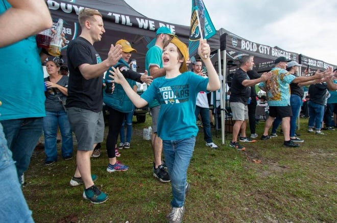 Fans fill the Bold City Brigade tailgate area during the Jacksonville Jaguars' game against the Indianapolis Colts on Dec. 29, 2019, at TIAA Bank Field. The BCBdecided before the current season began to suspend their tailgates and roadtrips for the entire year.