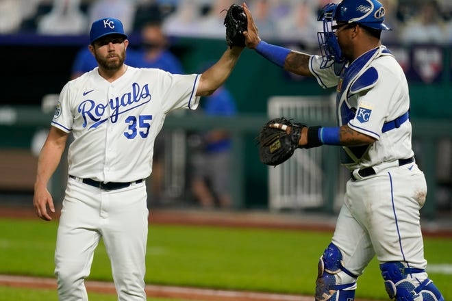 Kansas City Royals relief pitcher Greg Holland (35) is headed back to the Royals. [File AP Photo/Orlin Wagner]