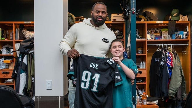 Tiverton's Shawny Smith, who died Sunday from an aggressive form of brain cancer, is seen here with his favorite football player, Fletcher Cox, whom he was able to meet earlier this year.