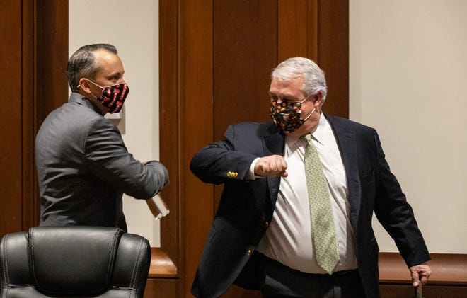Administration and Finance Secretary Michael Heffernan (right) greeted Rep. Aaron Michlewitz with an elbow bump before Tuesday's consensus revenue hearing, where budget officials heard relatively bright forecasts for fiscal 2022.
