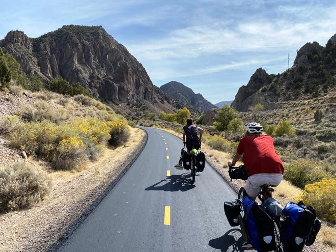 The view from Nico Khazzam's handlebars as he and friends Jack Downing and Zane Nyhus ride their bicycles through Utah. The three Peoria-area men spent part of the summer and autumn cycling across the United States, to raise money for charity and to learn more about the country and themselves.